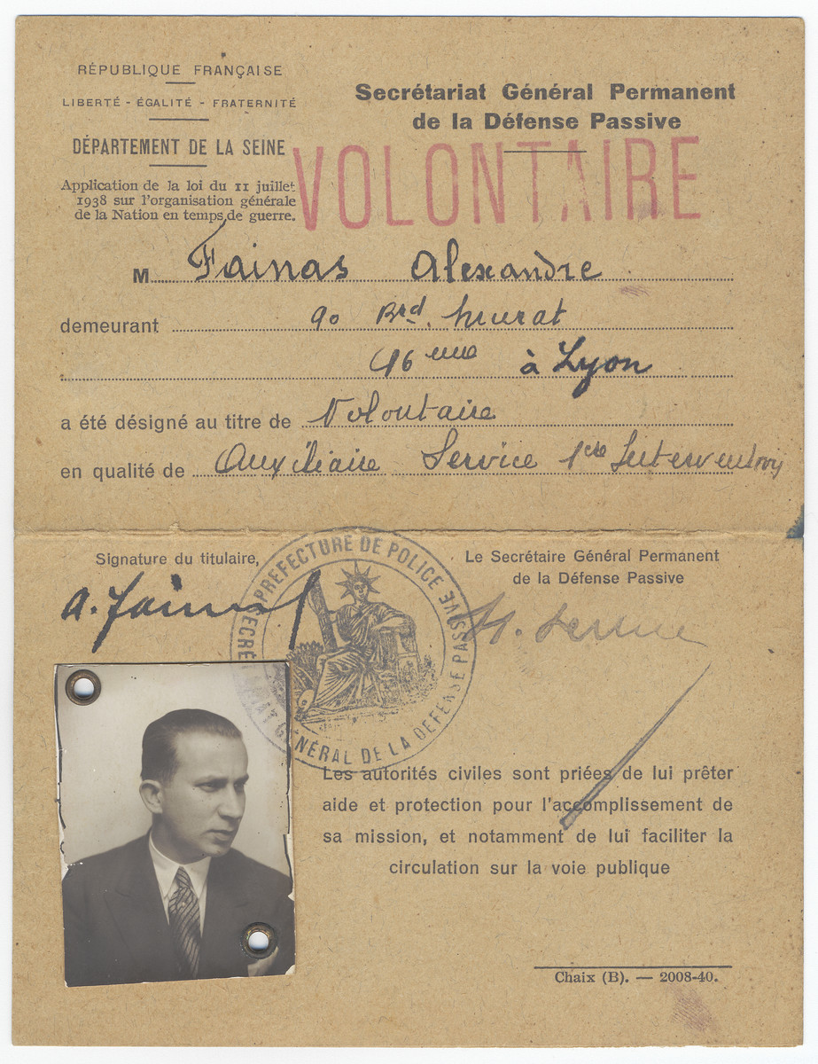 "Volunteer card for the Defense Passive issued to Alexander Fainas.    The card was probably issued to him when he volunteered to patrol to the streets and watch over people during the air raids at the start of the war.  It bears his address in Paris and was issued by the Departement de la Seine. However, someone later added the city ""Lyon"" to the address [perhaps to give Alexander Fainas the extra cover of a semi-official capacity while in hiding in Lyon]."