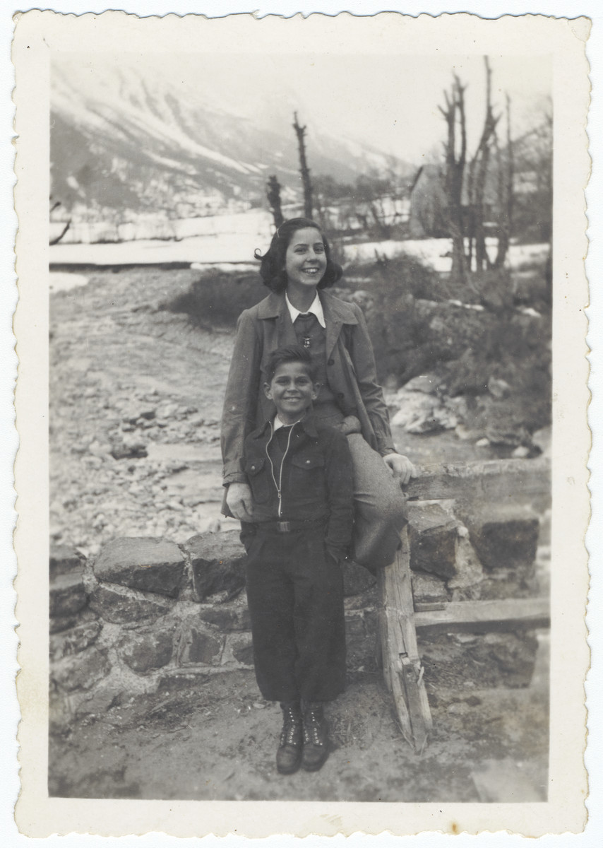 Two Jewish siblings pose outside in the snow in Lyon where they are living in semi-hiding under their own names.  Pictured are Renee and Josy Fainas.