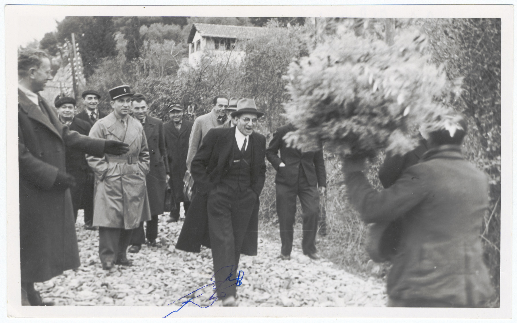A small town in the Alpes Maritimes celebrates its liberation.  Pictured in front is the mayor of the town who was also a member of the resistance.  Pictured in French uniform is Alexander Fainas.