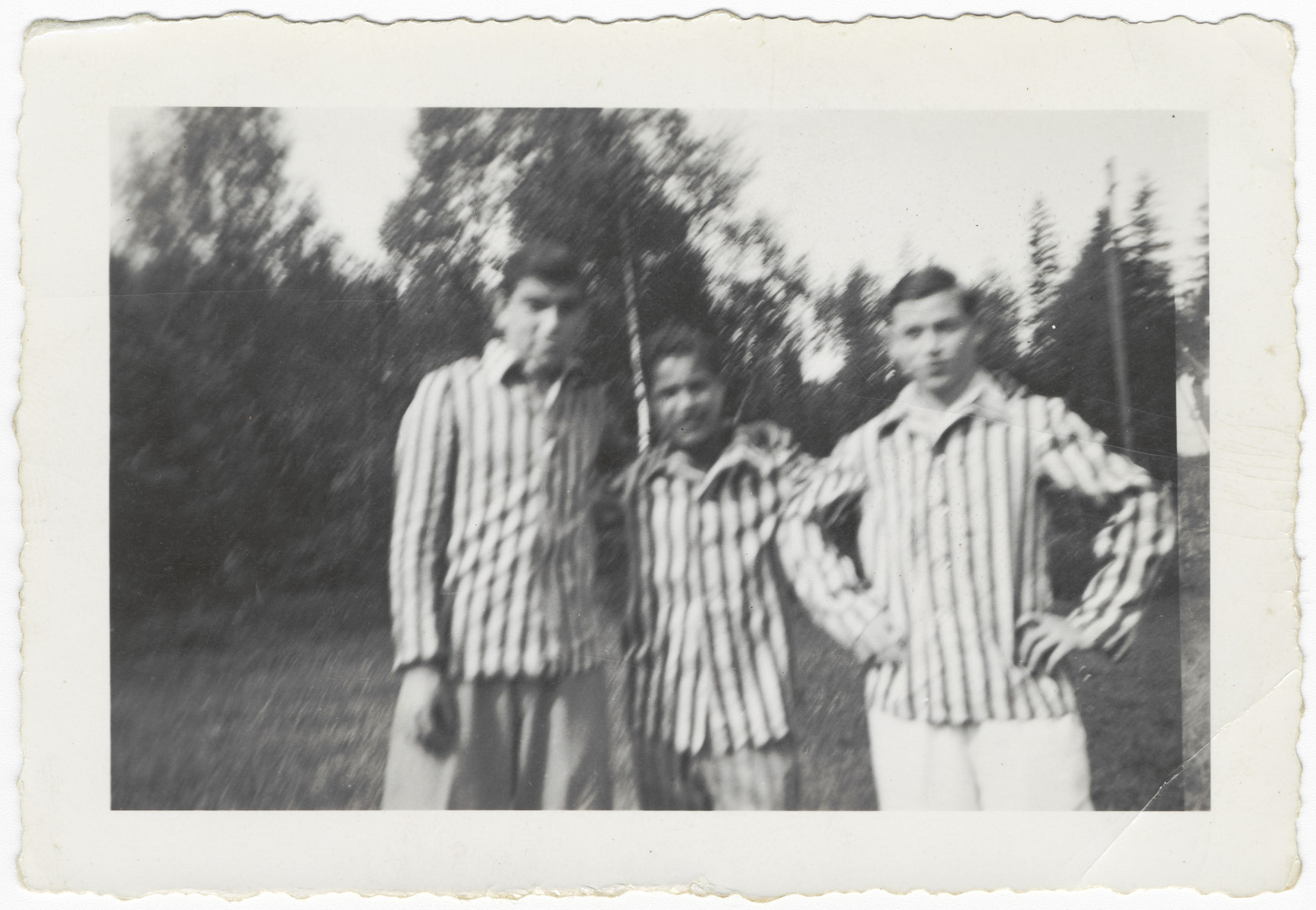 Three young Buchenwald survivors pose in their uniforms after liberation.  Moniek Szmulewicz is pictured in the center.