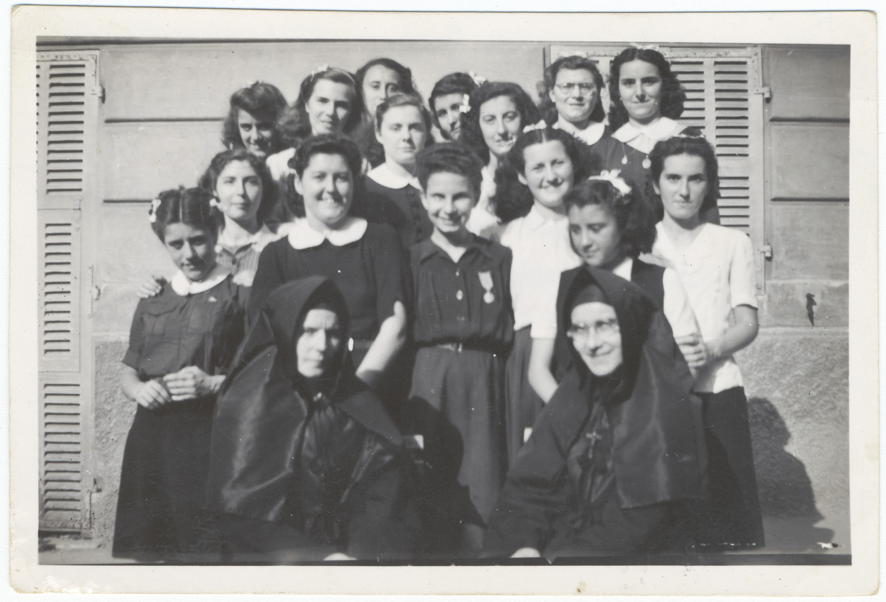 A group portrait of students at a Catholic convent in Monaco after the German seizure of the Italian zone in France.  Among those pictures is a Jewish girl in hiding.