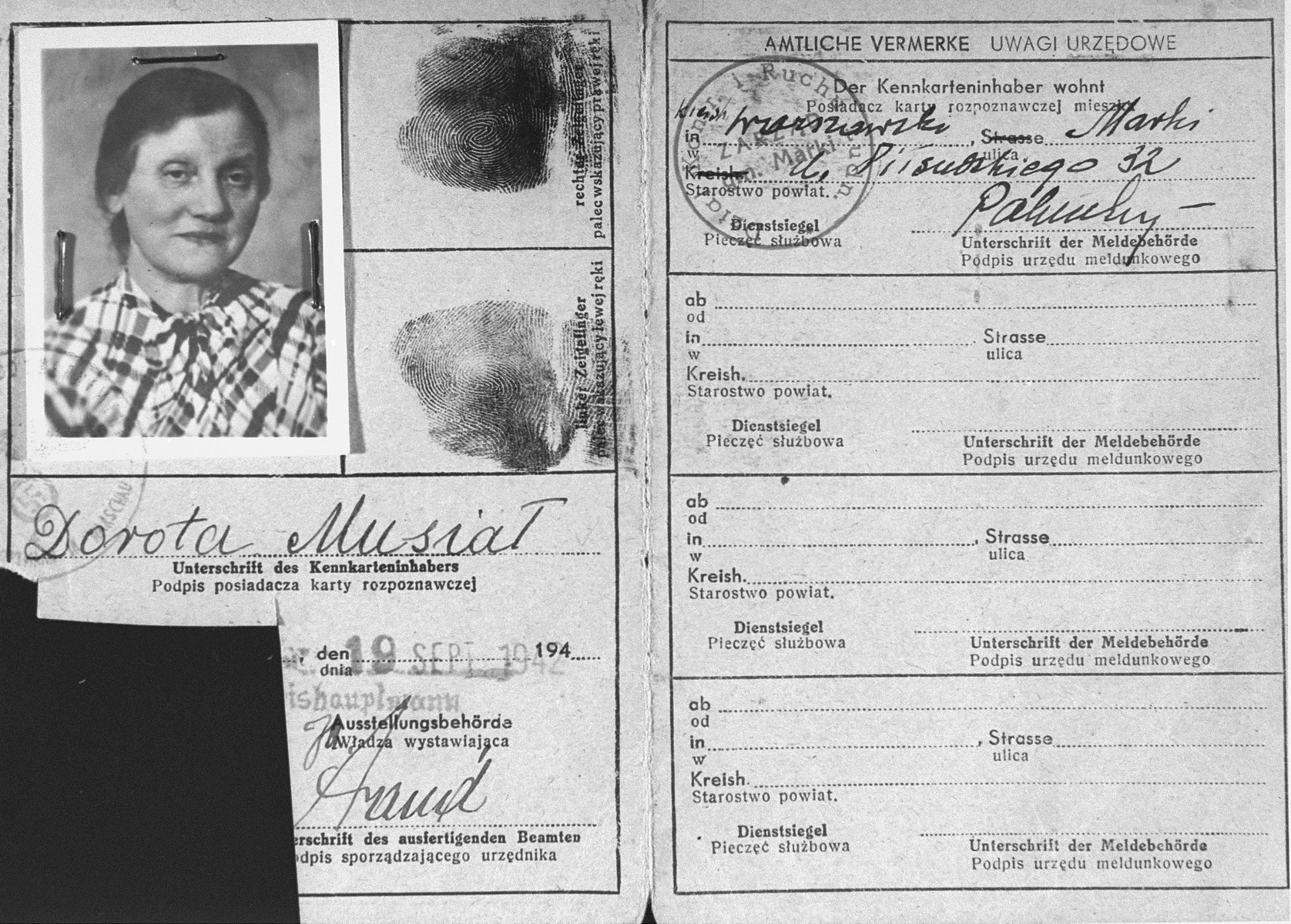 False identification papers used by the donor's mother  during her years of hiding in occupied Poland.