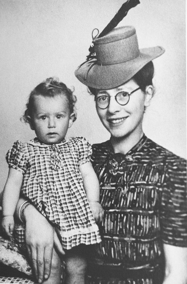 Semmy Woortman poses with Lientje, a nine month old Jewish girl she was hiding in her home.