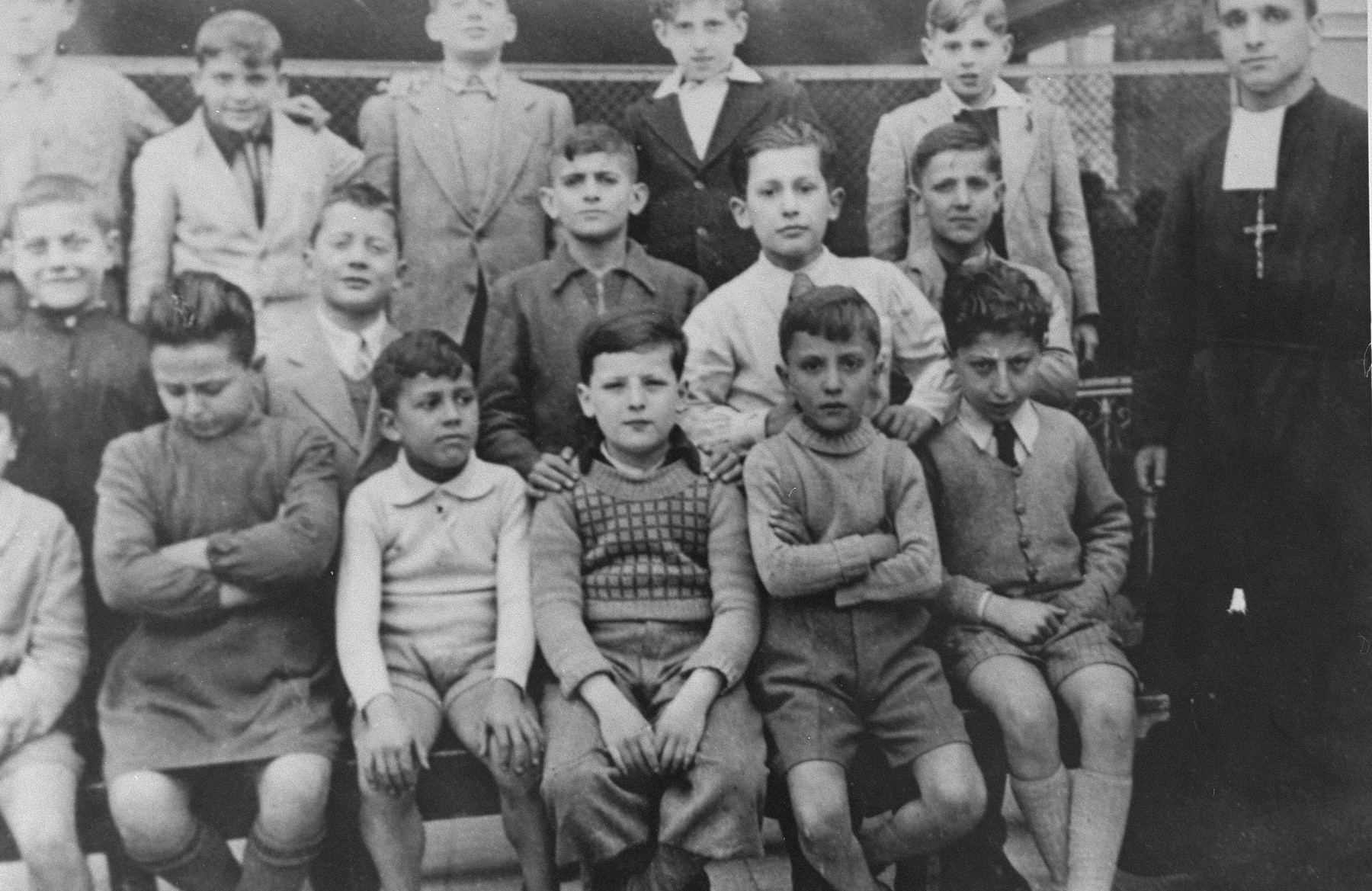 Class photograph of students at the San Leone Magno Fratelli Maristi boarding school in Rome.    Pictured in the top row at the far right is Zigmund Krauthamer, a Jewish child who was being hidden at the school.