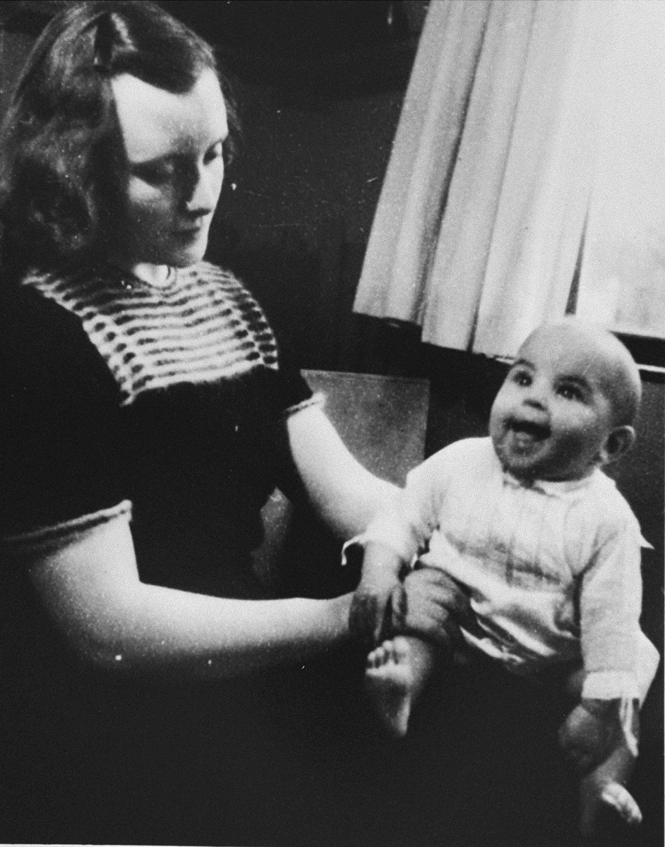 Dutch rescuer Marion Pritchard poses with the Jewish infant, Erica Polak, whom she is hiding.