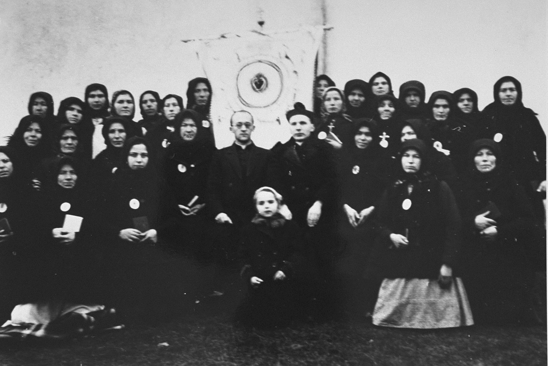 Anita (center)  pictured with Father Kujata and his parishioners.