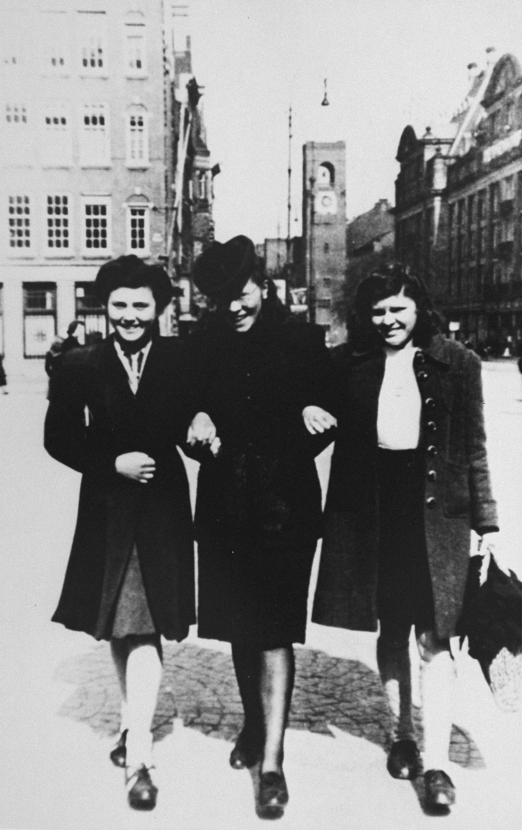 Semmy Woortman walks along a street in Amsterdam with her stepdaughter Hetty (left, Joop's daughter) and her Jewish foster child, Rachel (right).