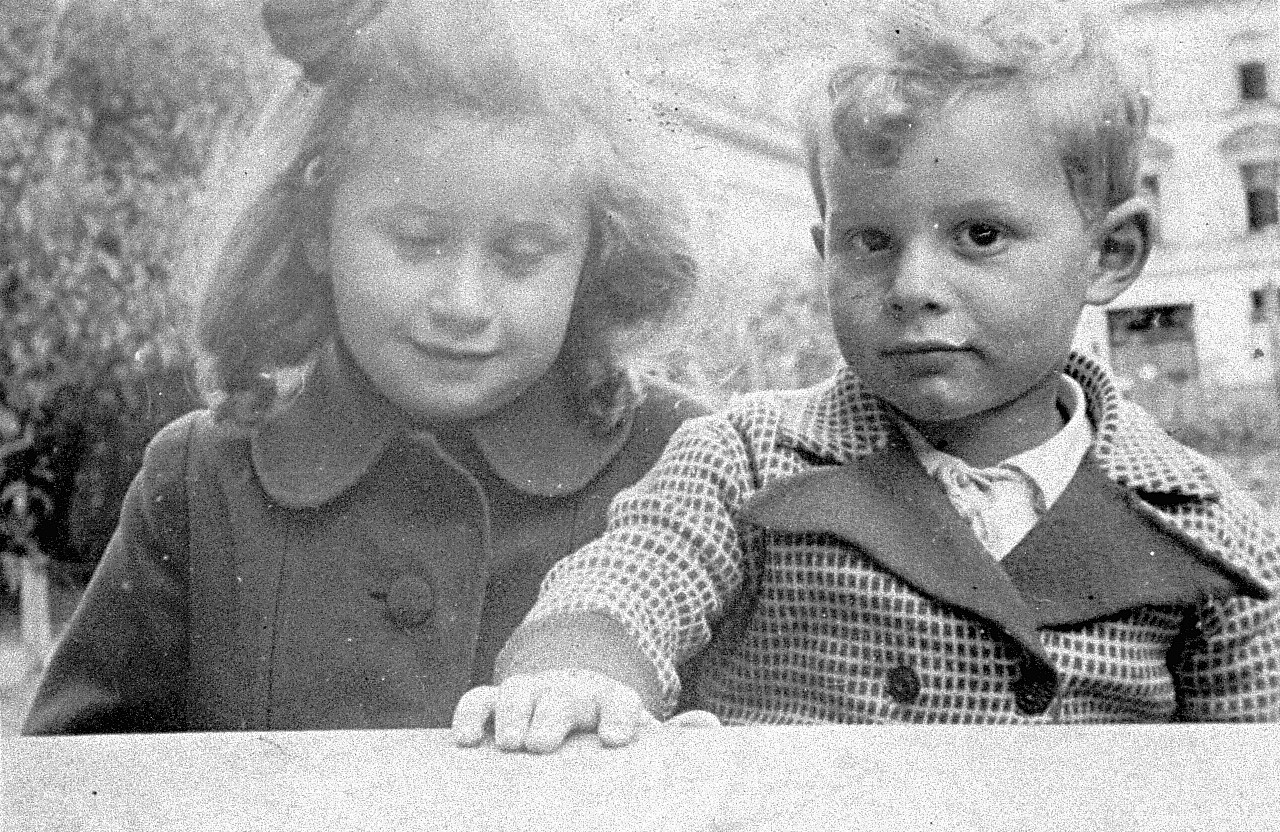 A little Jewish girl living in hiding in Warsaw, poses with her Polish playmate.  Pictured at the left is Rita Berkowicz, the donor's daughter.