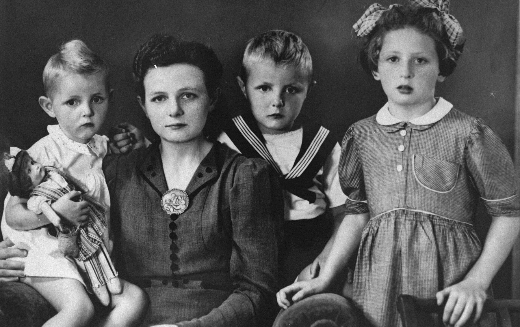 A Jewish child in hiding poses with members of the Dutch family that adopted her.  Pictured is the donor, Henny Kalkstein (right) with Dieuwke Hofstede and her two sons, Maaike and Andries.   Philip and Dieuwke Hofstede were each honored by Yad Vashem as one of the Righteous Among the Nations.