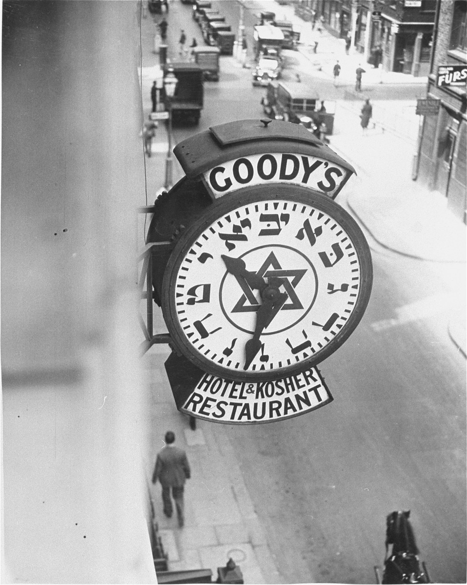 A clock with Hebrew numerals advertising a Jewish hotel and kosher restaurant hangs from the side of a Noel Street building in London's West End.