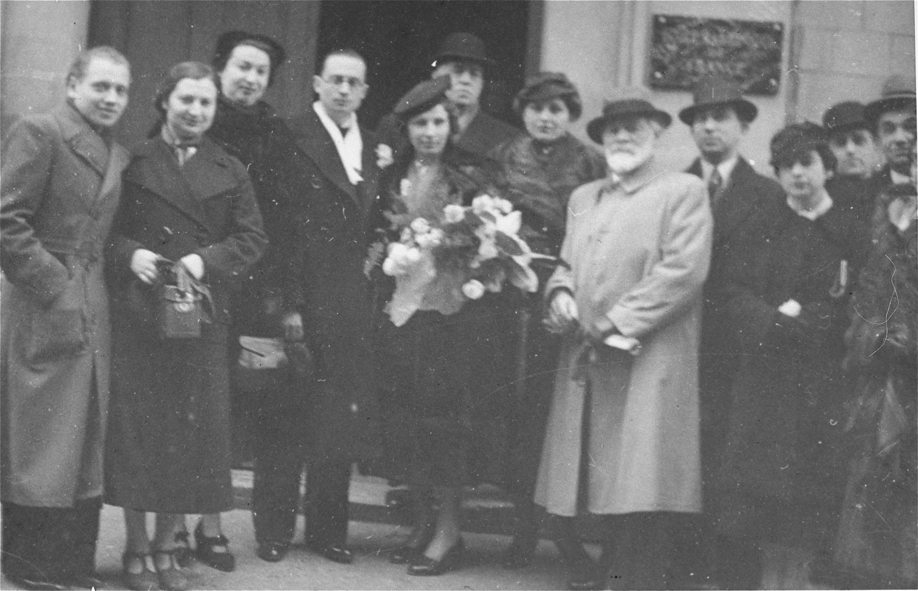 Wedding portrait of Raya Magid and Alexander Markon.   Among those pictured is the Jewish sculptor, Nahum Aronson (the bearded man on the right); the photographer Jacques Simpson (on the far left); the groom's sisters, Paula Markon Raizman and Olga Markon Baumgarten (to the left of the groom).  They all survived the war and immigrated to the U.S.  Also pictured are Luba Speiglass Fainas (behind the bride); and Sasha Fainas (next to Nahum Aronson).  Both survived the war in hiding in Lyons.