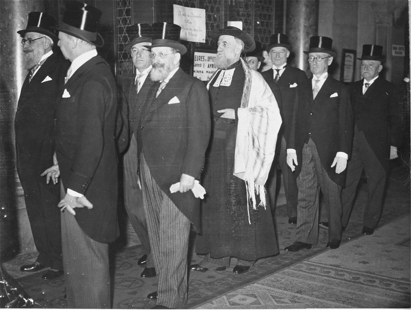 Rabbi Isaie Schwartz is escorted by leaders of the Jewish community to the synagogue where he will be installed as the new Chief Rabbi of France.