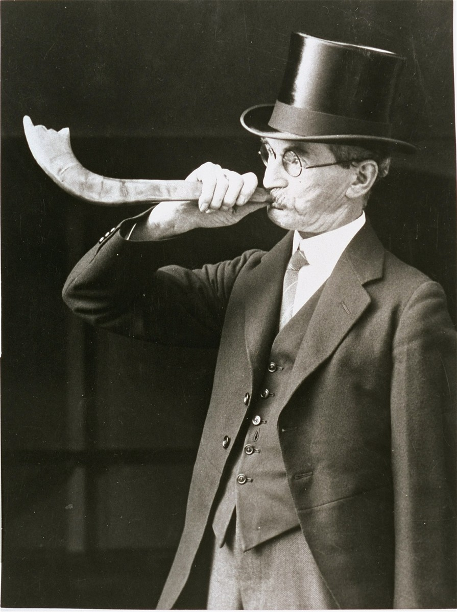 Portrait of a British Jew blowing a shofar during the high holidays.