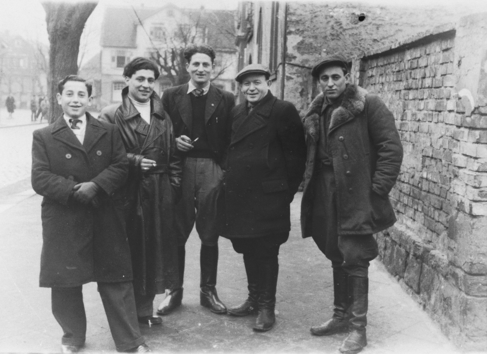 A group of young Jewish DPs pose on a street in the Lampertheim displaced persons camp.  Among those pictured is Izak Lachter (far right).