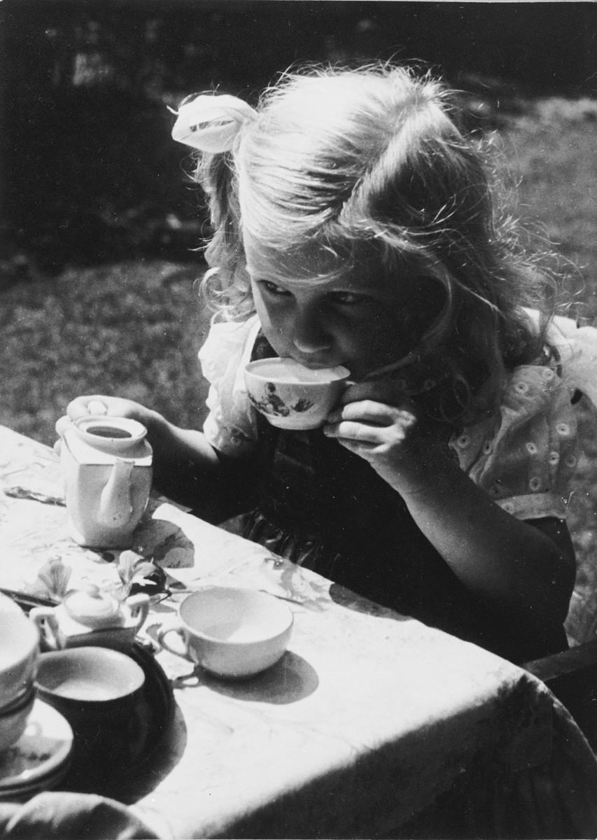 "Portrait of Siny Natkiel at a ""tea party""."