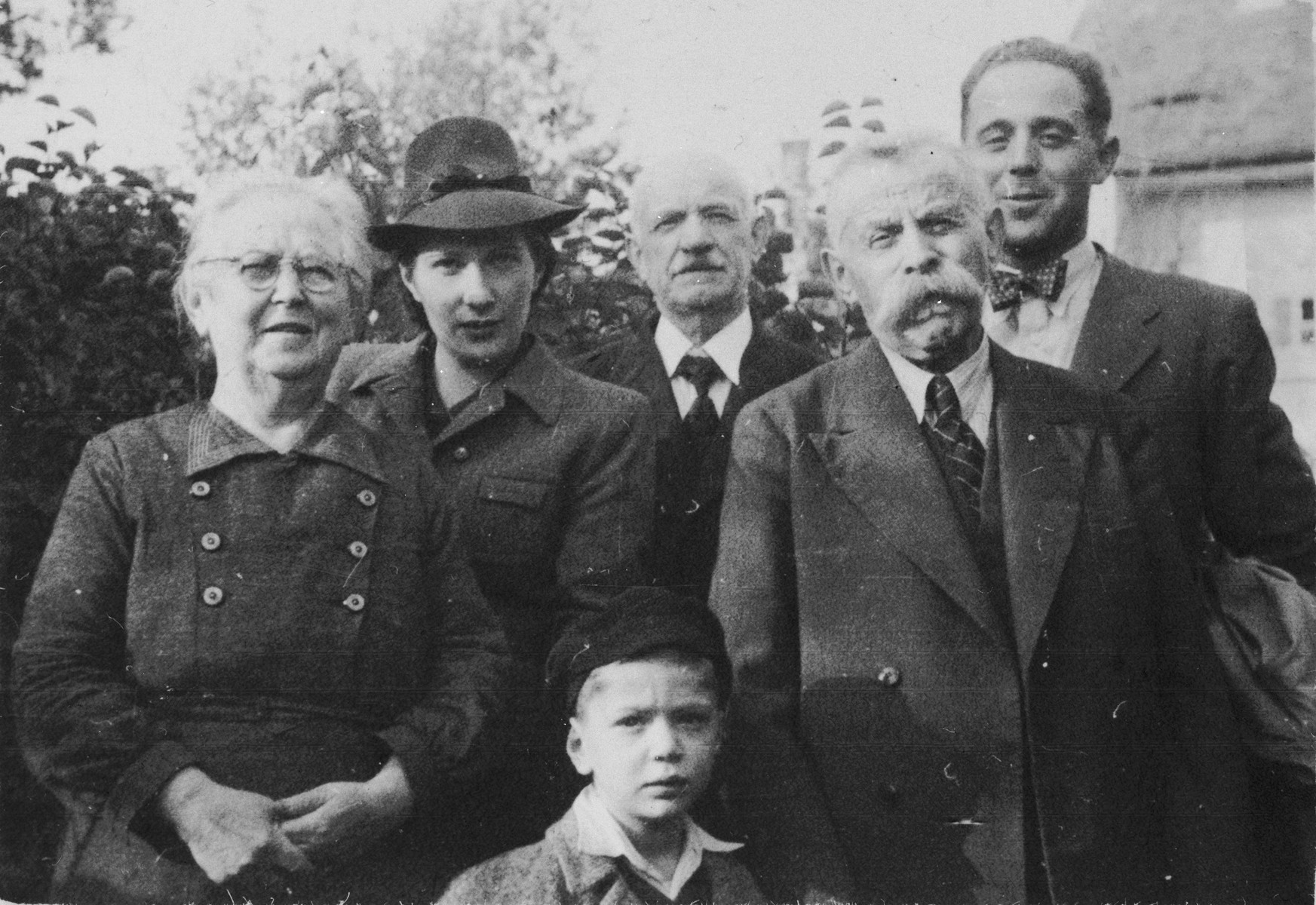 Julius and Fanny Goldstein pose with their son, Bohus, and members of his family.    Pictured from left to right are Fanny, Wilma Goldstein, Michael, Max Redlich (Wilma's father), Julius and Bohus.  Bohus and Wilma (Redlich) Goldstein had two children, Eva and Michael.  The family lived in Olomouc, where Bohus worked for the Prague autoworks.  They all perished during the war.