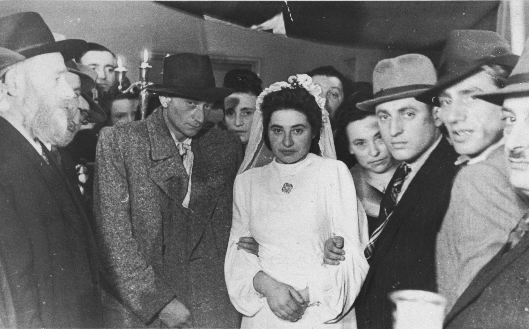 Jewish DPs are wed in a ceremony in Heidelberg, Germany.  Pictured are the bride and groom, Toby and Bernard Weitschner.  Standing next to them on the right are Chava and Izak Lachter.