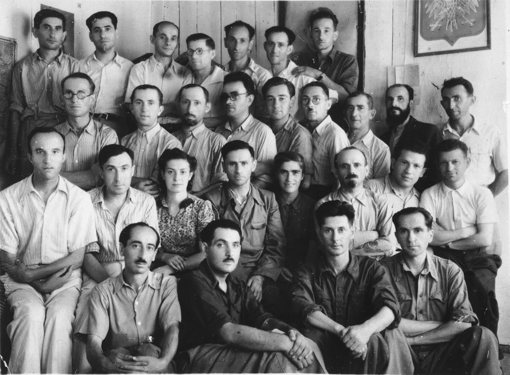Group portrait of Polish Jewish refugees in Samarkand, Uzbekistan.  Among those pictured is Peretz Miransky (top row, third from the right).