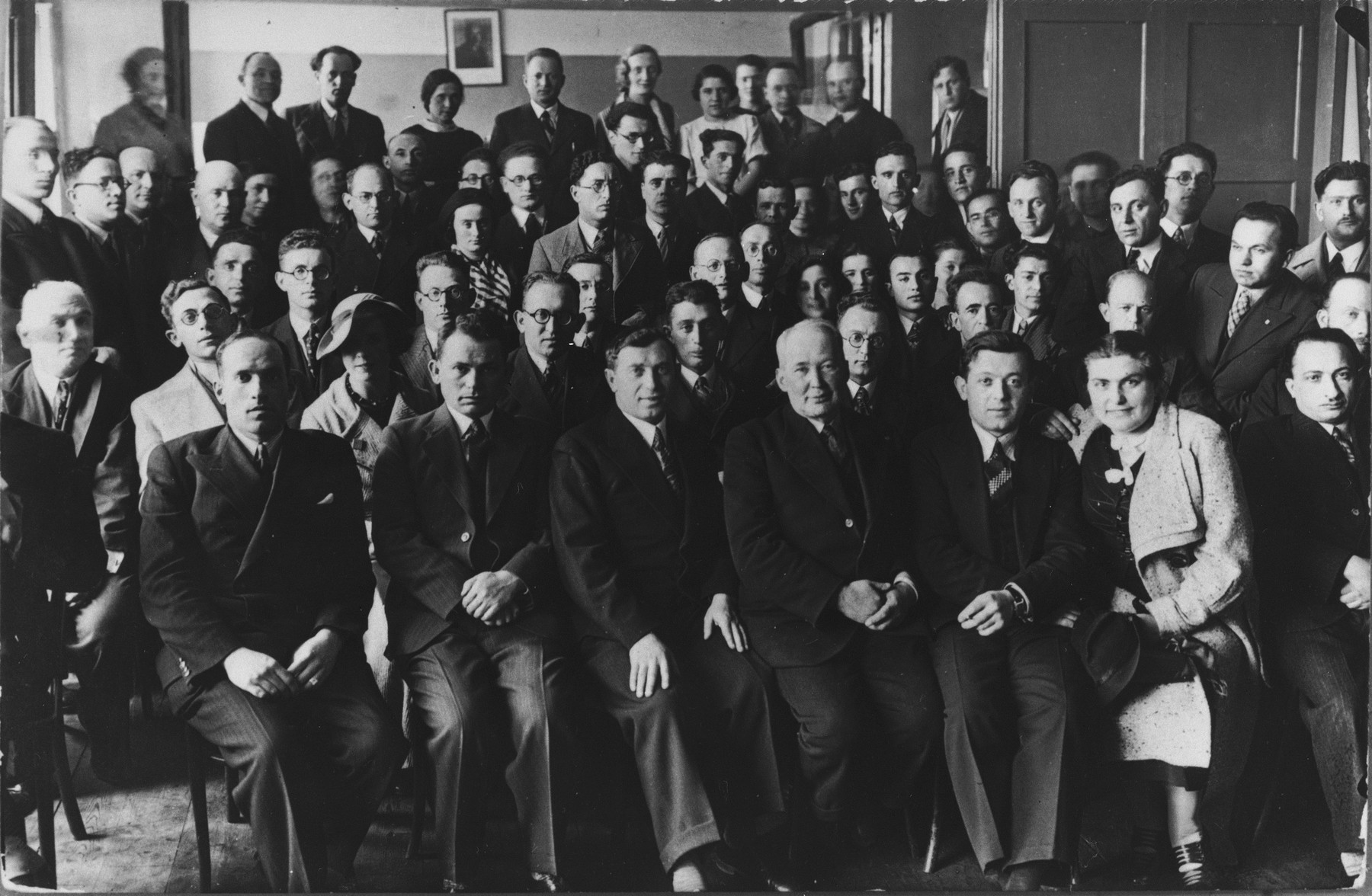Group portrait of Jewish Tarbut school teachers at a national convention.    Among those pictured is Ralph Denishevsky (front row, left).