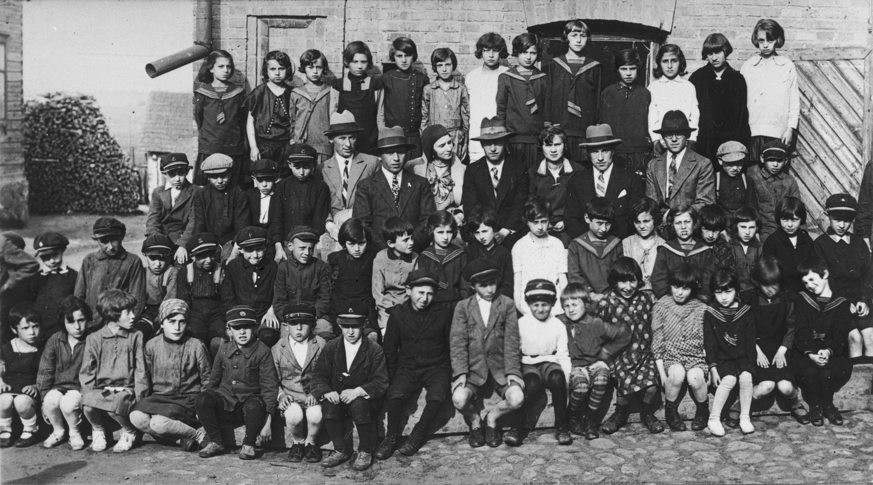 Group portrait of students and teachers at the Hebrew language Tarbut school in Grodek.    Among those pictured is Ralph Denishevsky (third row, fourth from the right).
