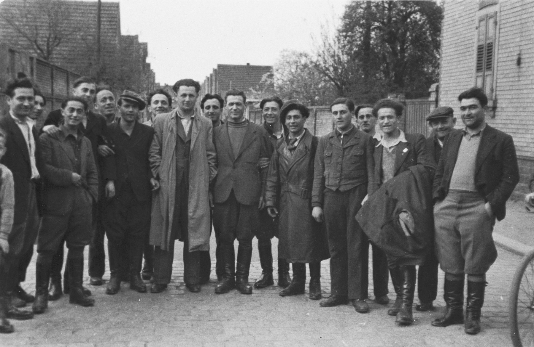 Group portrait of young Jewish DPs on a street in the Lampertheim displaced persons camp.