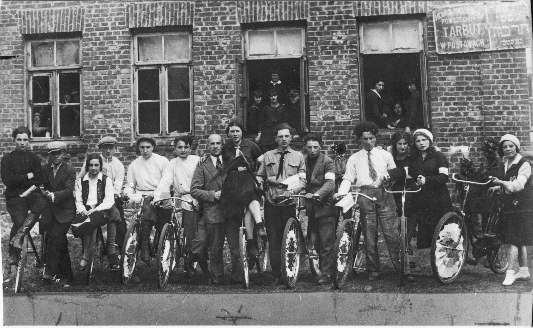 Group portrait of students and teachers at the Hebrew language Tarbut school in Postawy with their bicycles.    Among those pictured is Ralph Denishevsky (seventh from the left).