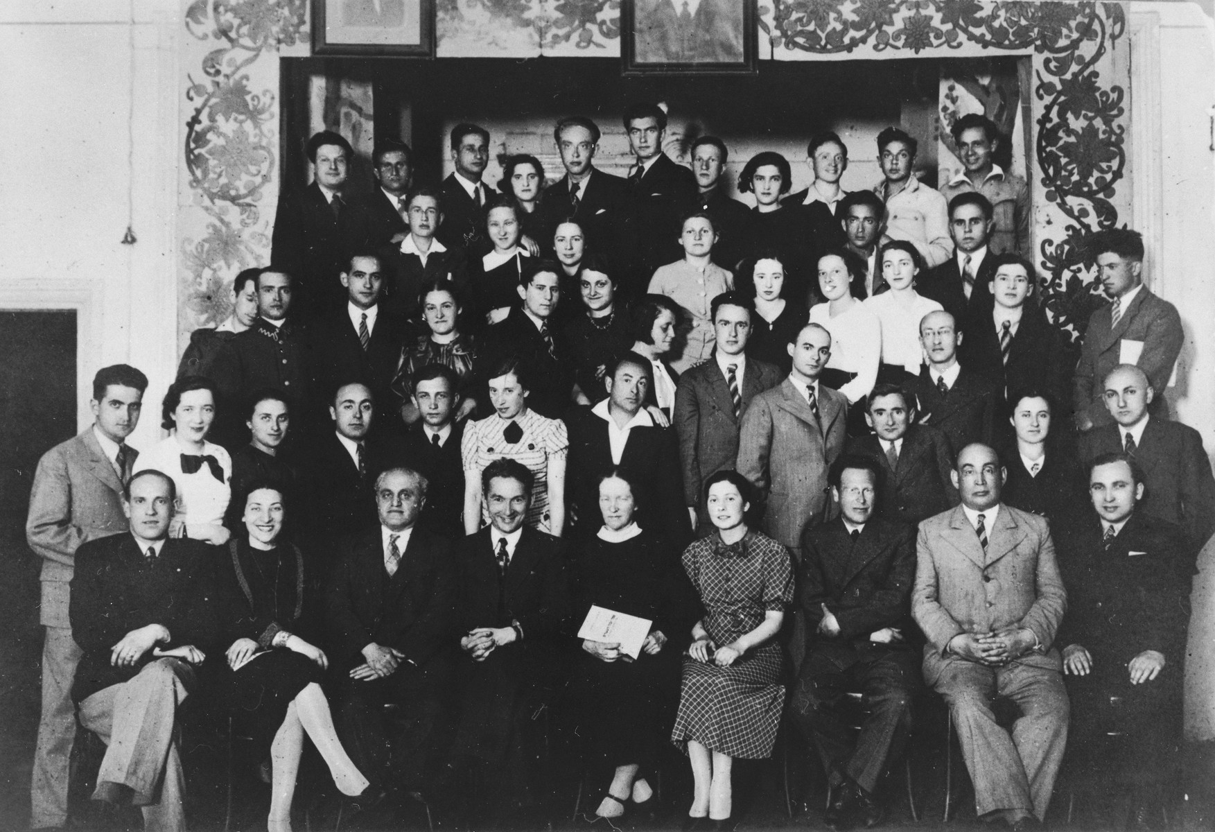 Group portrait of the alumni of the Hebrew language Tarbut school in Vilna taken on the twentieth anniversary of the Hebrew gymnasium.    Among those pictured is Ralph Denishevsky (front row, left).
