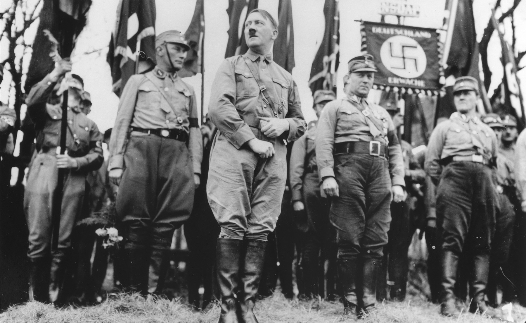 Adolf Hitler leads an SA unit in a Nazi party parade in Weimar ...