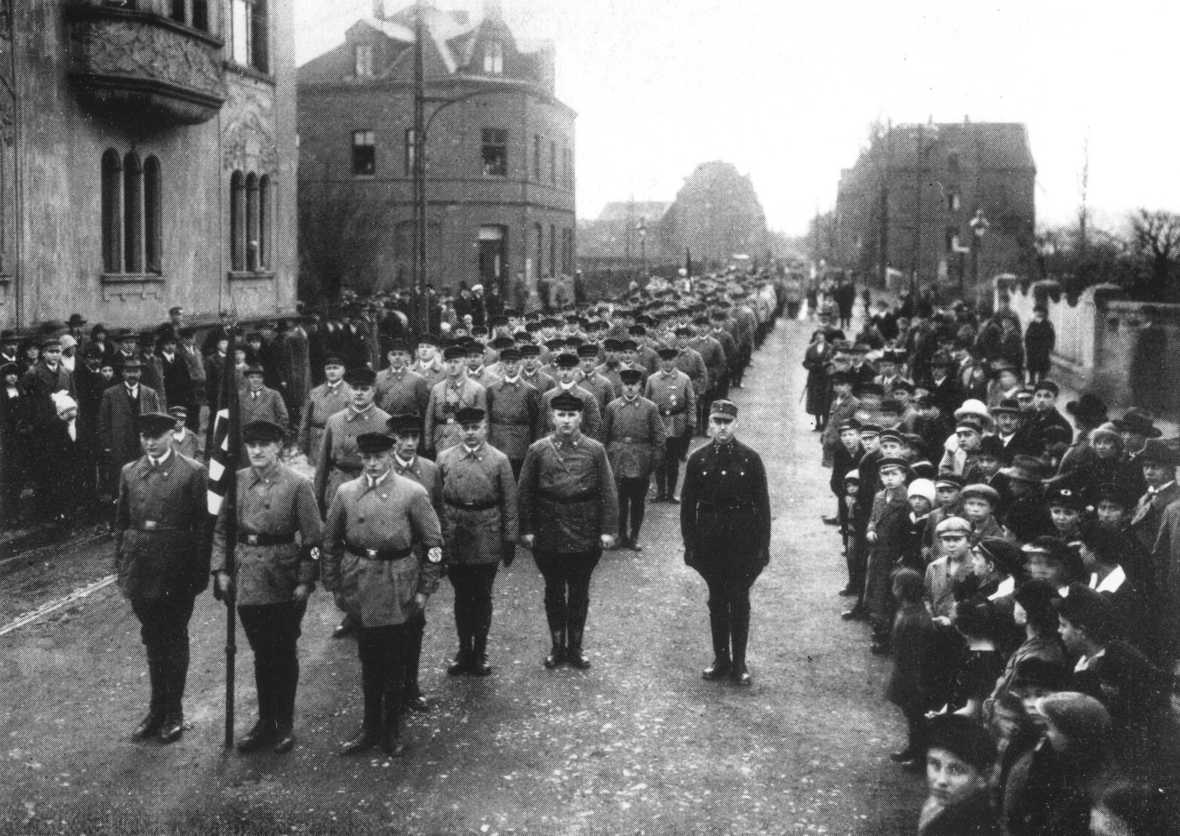 Local residents line the streets during an SA march in an unidentified German town.