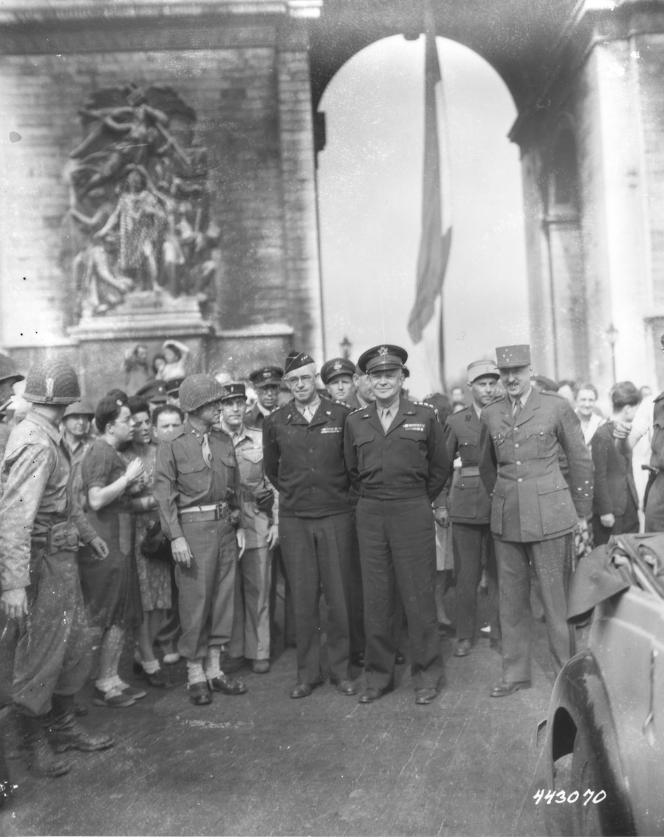 Supreme Allied Expeditionary Force Commander, General Dwight D. Eisenhower poses beneath the Arc de Triomphe with ranking French, British and American officers during a ceremony celebrating the liberation of Paris.
