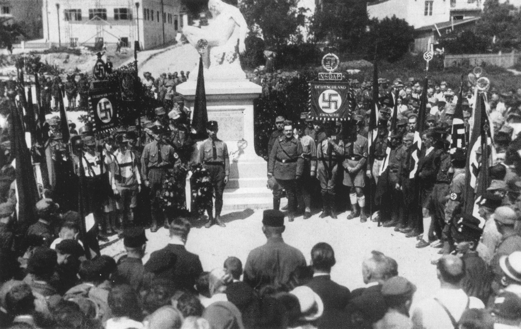 On Gautag [District Day] SA members attend a memorial gathering in front of a monument in Starnberg.
