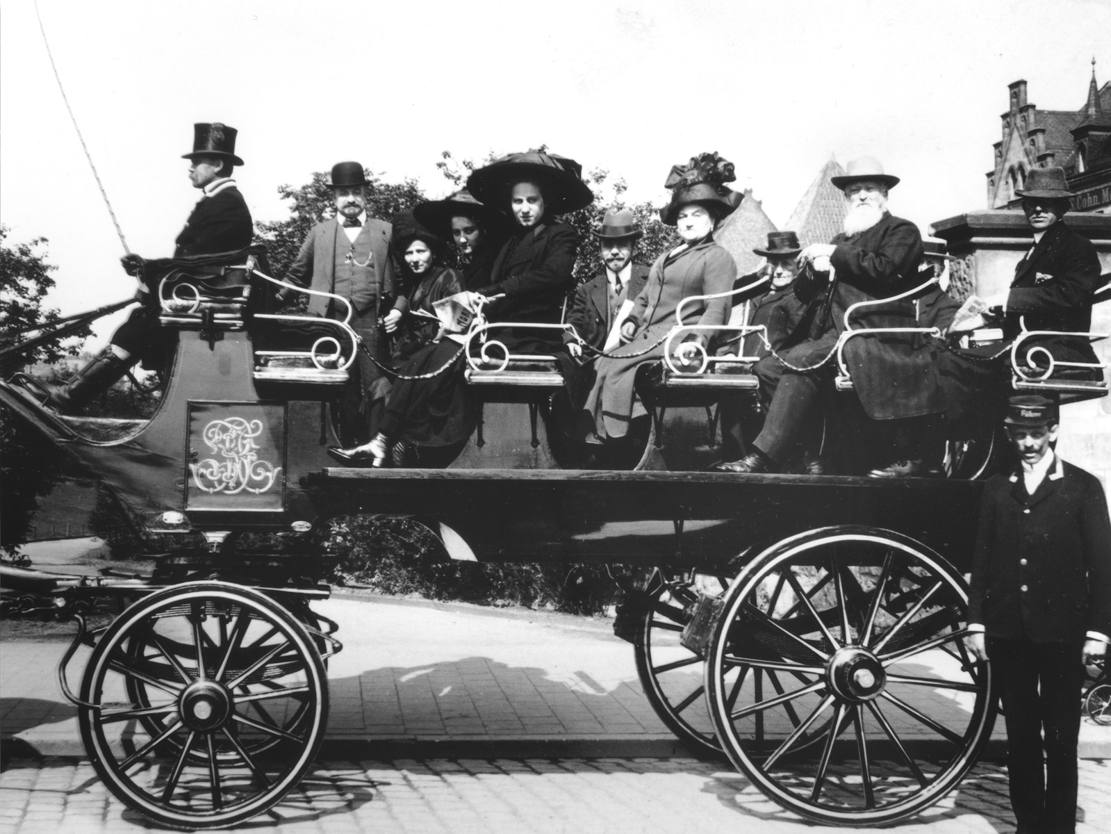 The Gottschalk family riding in a horse-drawn carriage.    Pictured behind the coachman are Hugo, Bertha, Gertrud and Kaethe Gottschalk.