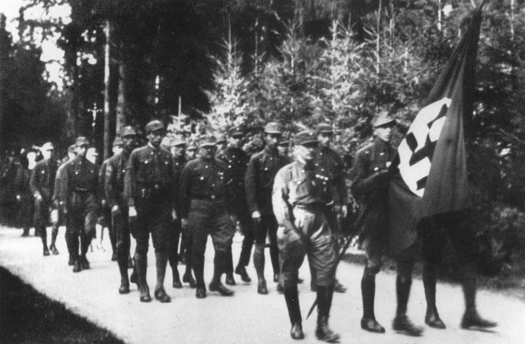 Members of the SA march in a funeral procession at a cemetery in Munich.