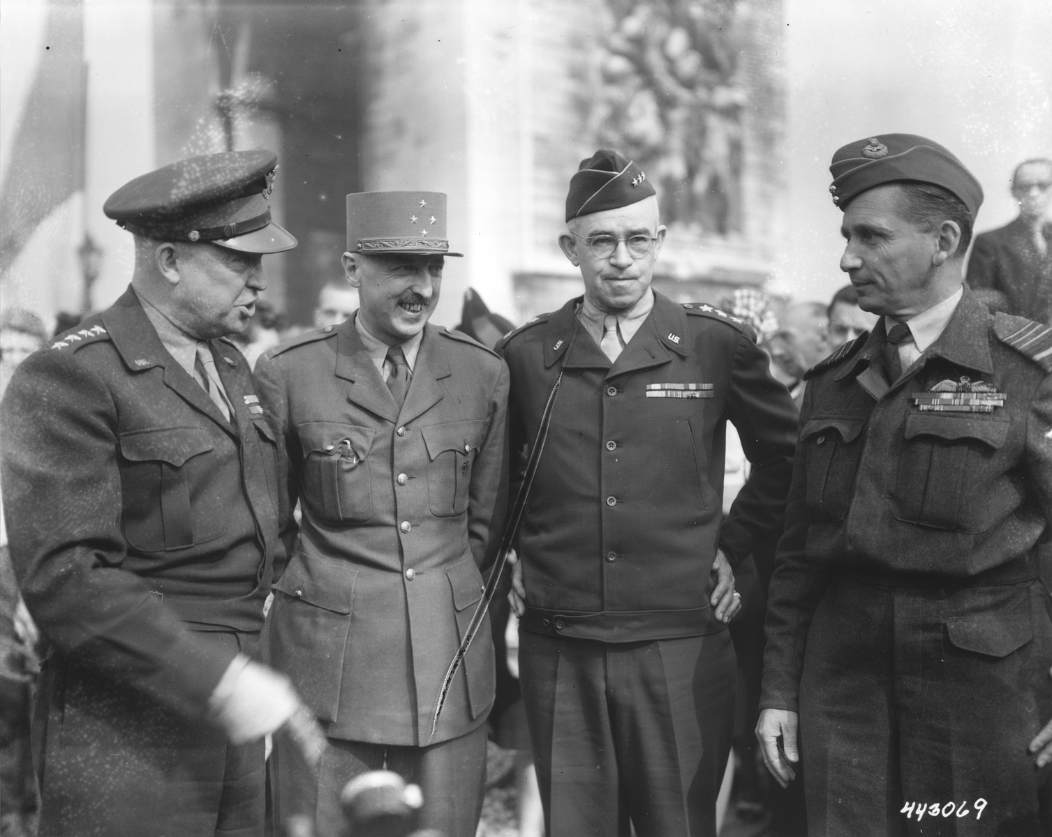 General Dwight D. Eisenhower confers with ranking French, British amd American officers at the Arc de Triomphe.    Pictured from left to right are General Dwight D. Eisenhower, General Joseph Koenig, Lt. General  Omar N. Bradley, and Marshal Arthur Tedder.