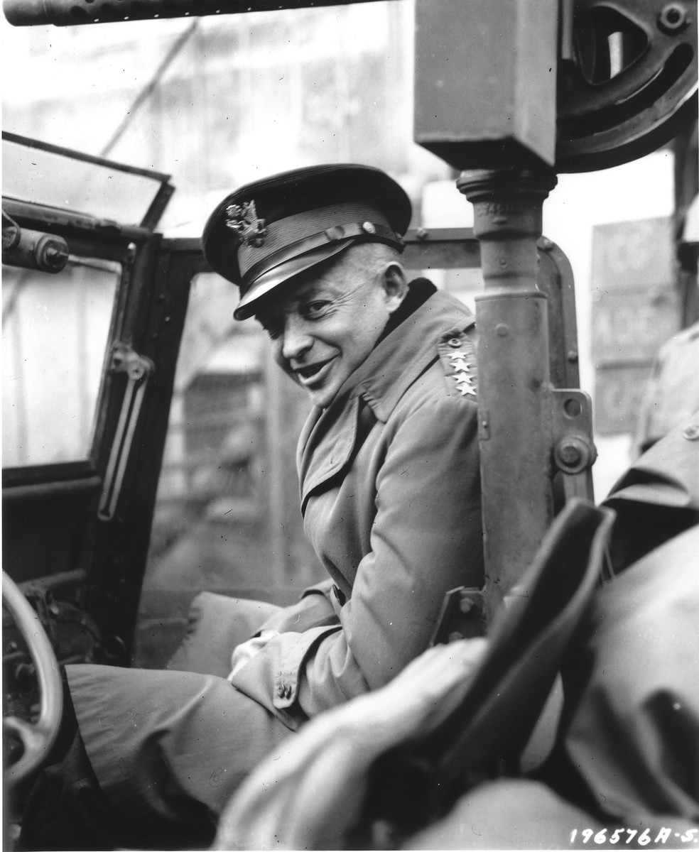 Portrait of General Dwight D. Eisenhower sitting in a jeep, ready to begin a tour of the front.