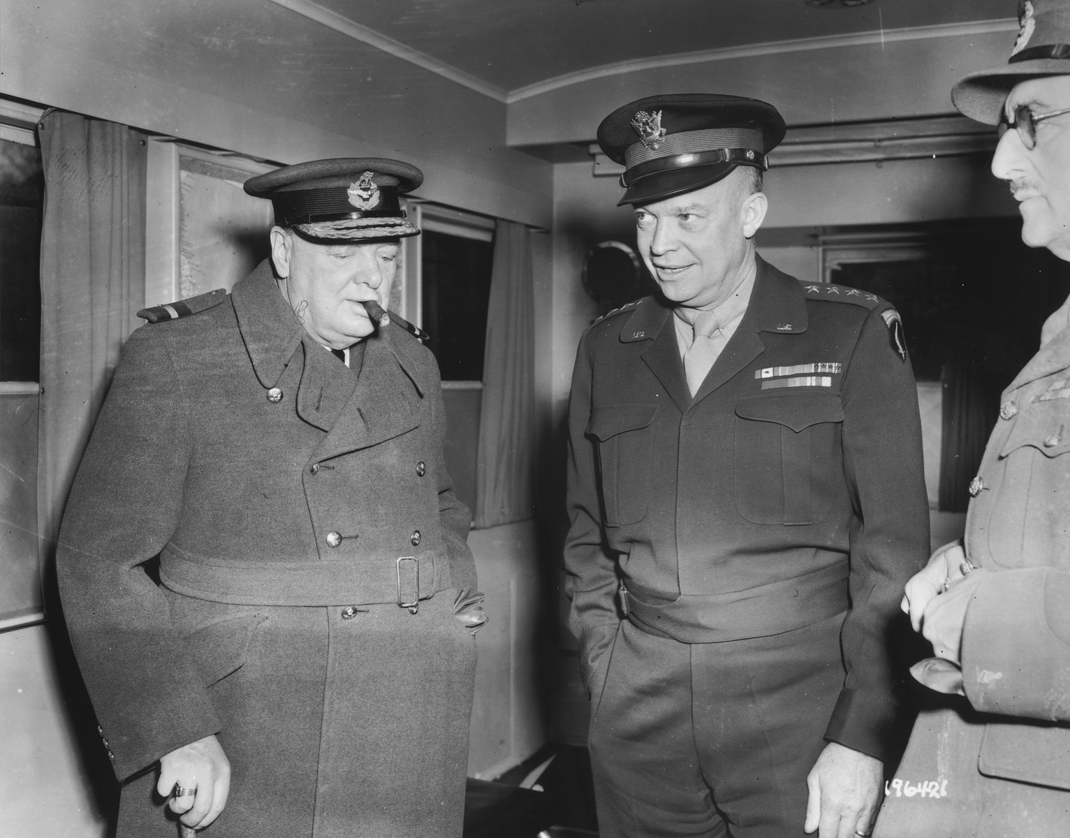 Prime Minister Winston Churchill and General Dwight D. Eisenhower confer on the progress of the war.