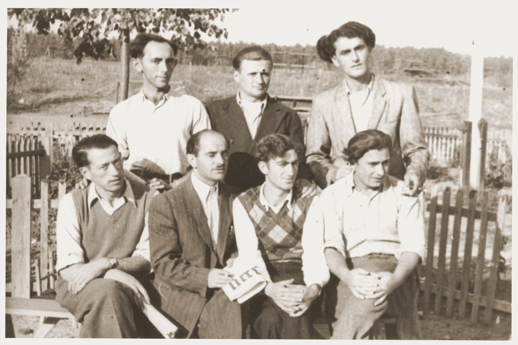 Group portrait of members of the Kibbutz Nili hachshara (Zionist collective) in Pleikershof, Germany.    Among those pictured is Noach Miedzinski (front row, second from the left).
