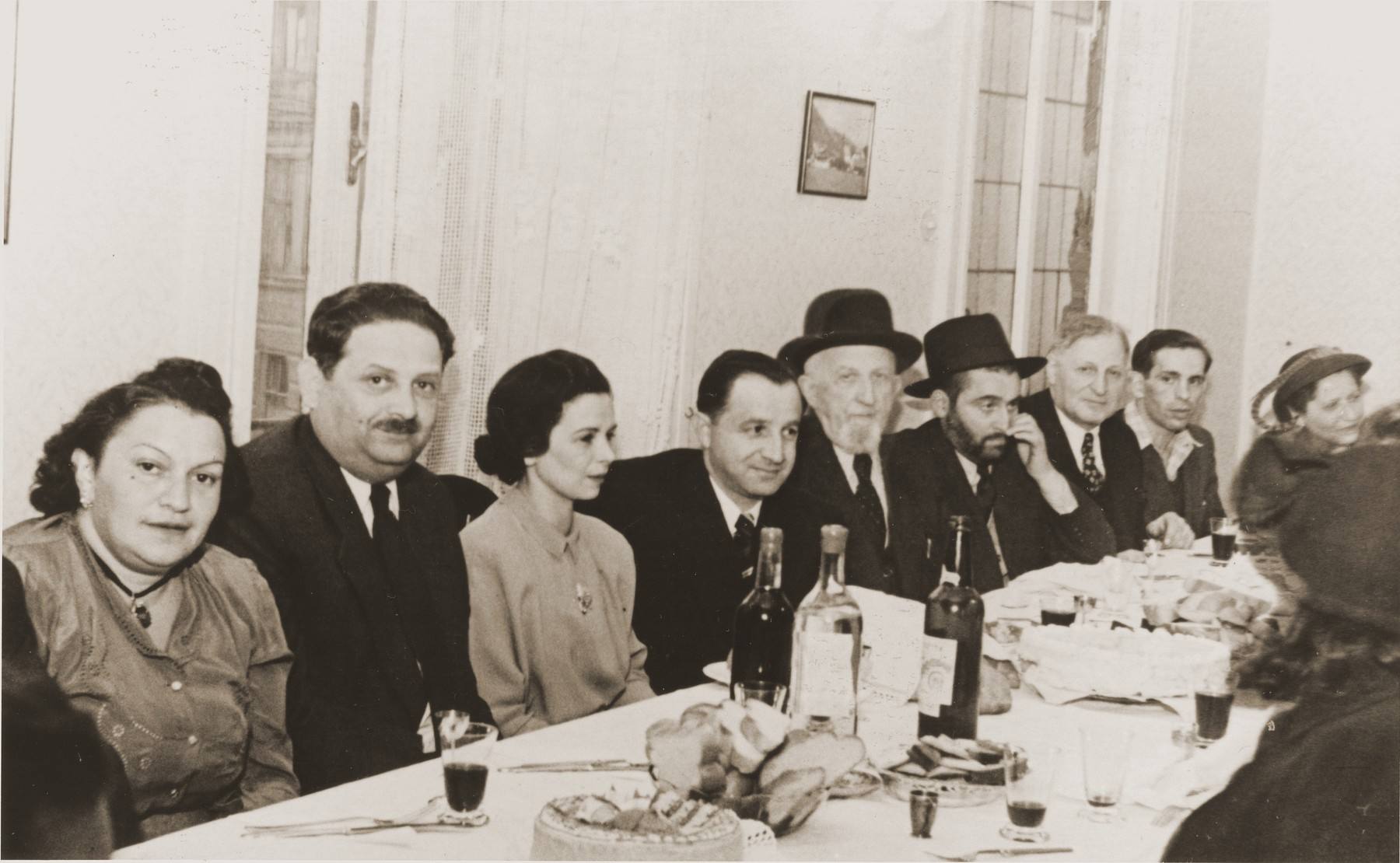 Jewish DPs celebrate at a banquet at the Rothschild Hospital.  Seated in the center is Kravetz, chief of security.  Third from the left is Abel Birman.