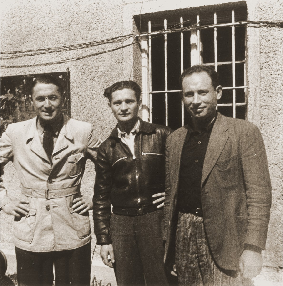 Three Jewish DPs, who survived both the Kovno ghetto and Dachau concentration camp, pose together at the Saint Ottilien Hospital displaced persons camp.    On the left is Max Lurie.