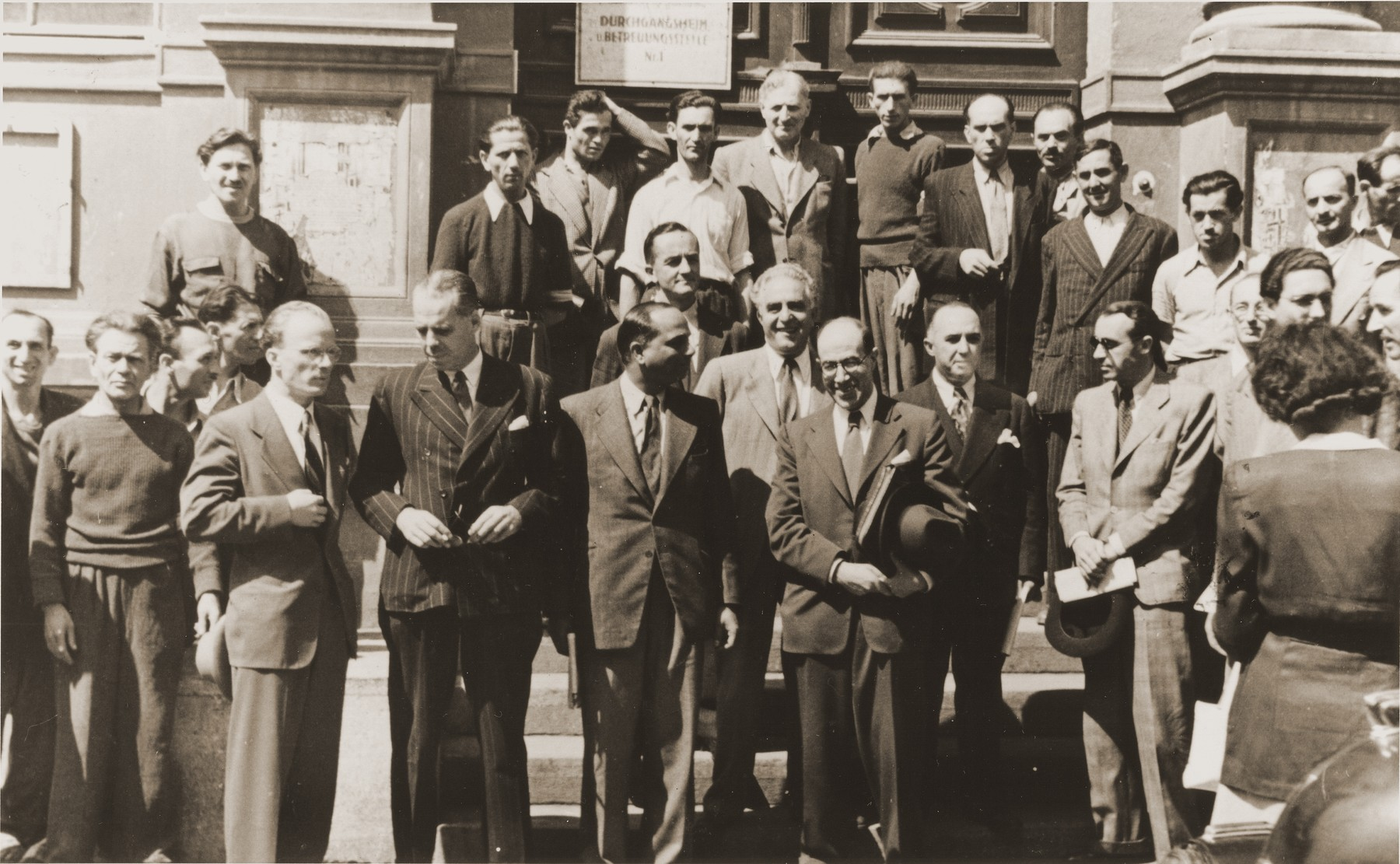 Members of the United Nations Special Commission on Palestine pose on the steps of the Rothschild Hospital during their visit to Vienna.  Bronislow Teichholz, the director of the hospital, is pictured in the center.