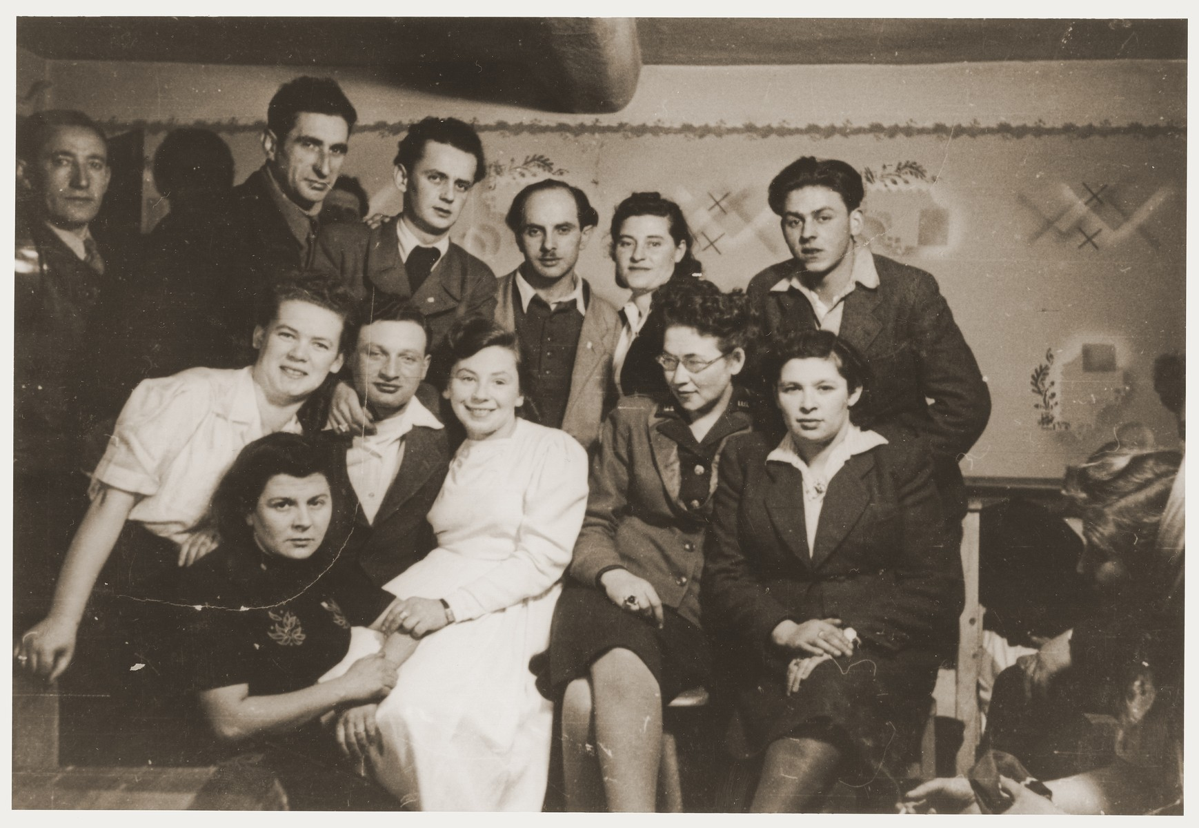 Group portrait of members of the Kibbutz Nili hachshara (Zionist collective) at the wedding of two of their members.    Among those pictured are Noach and Sara (Feldberg) Miedzinski (in the back row center).  Noach frequently performed weddings in the camp.