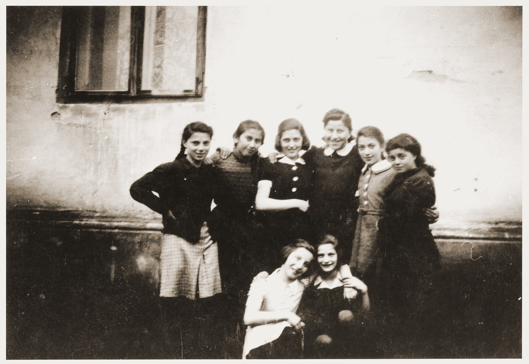 Group portrait of Jewish girls in the Zabno ghetto taken on the occasion of the twelfth birthday of Hania Goldman.  Among those pictured are Hania Goldman (bottom left) and her sister, Rachela (standing third from the right).