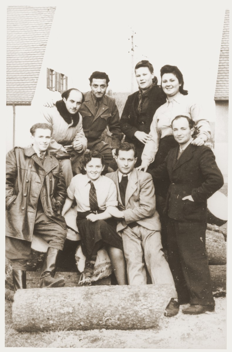 Group portrait of members of the Kibbutz Nili hachshara (Zionist collective) in Pleikershof, Germany.    Among those pictured is Nussia Applebaum (front row, center) and Noach Miedzinski (top row, left).