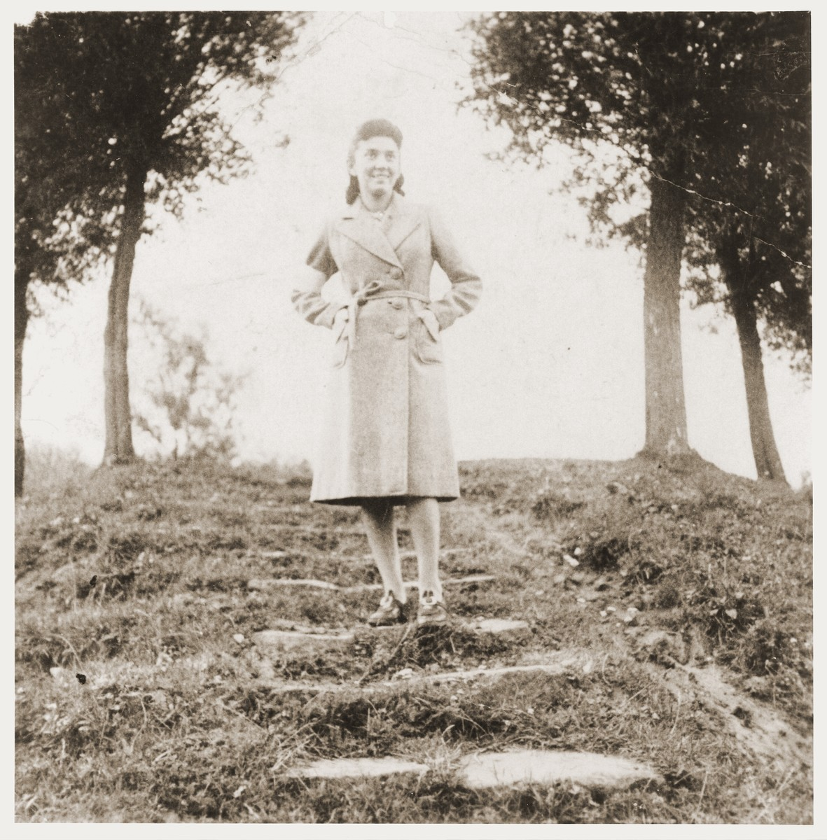A Jewish girl, wearing an armband, poses in a park in Zabno.    Pictured is Ms. Meyerhof, the daughter of a hardware store owner in Zabno.  She did not survive.