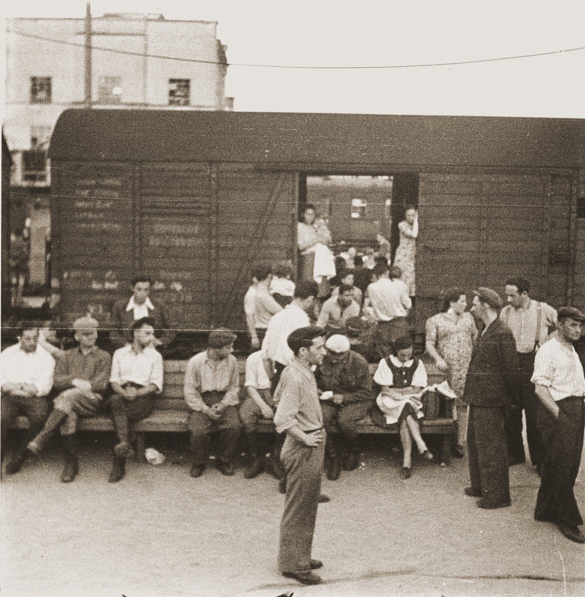 A group of Jewish DPs traveling along the Bricha route to the American Zone of Germany, board a box car at the Vienna railroad station.