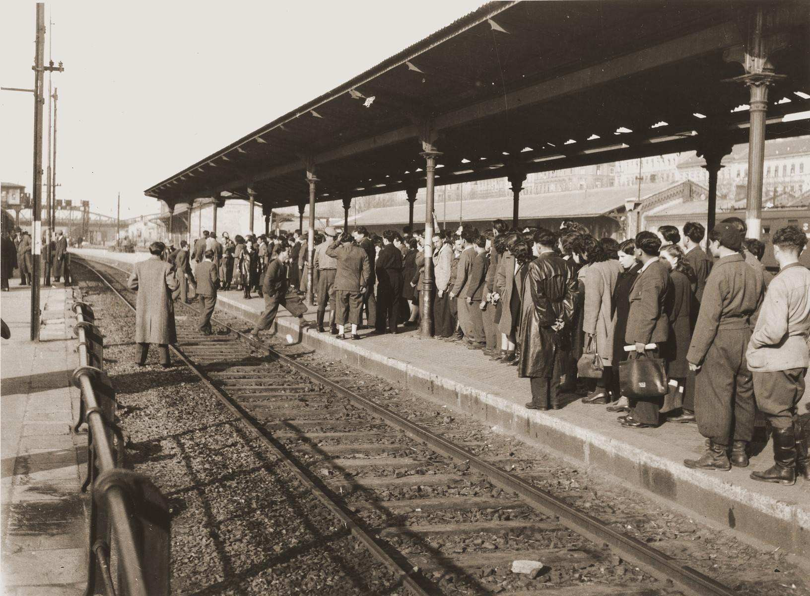 A group of Jewish DPs waits at the Vienna railroad station for a train to take them on the next leg of their journey along the Bricha route to the American Zone of Germany.