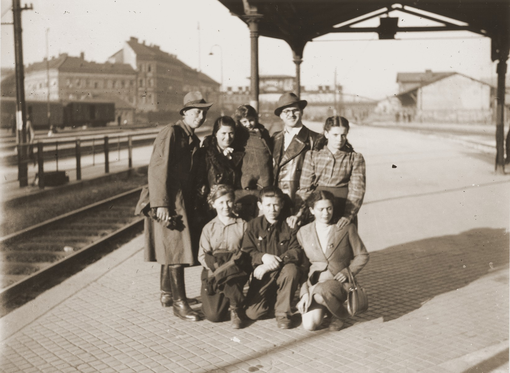 A group of Jewish DPs wait at the Vienna railroad station for a train to take them on the next leg of their journey along the Bricha route to the American Zone of Germany.  In the back row on the right is Brichah leader, Itzchak Wenglishevski.