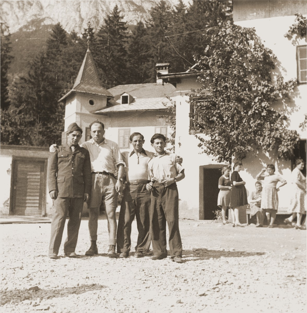 Four Bricha guides pose in the Gnadenwald transit camp, located in the Tyrol mountains, a stopping point on the Bricha route from Austria to Italy.
