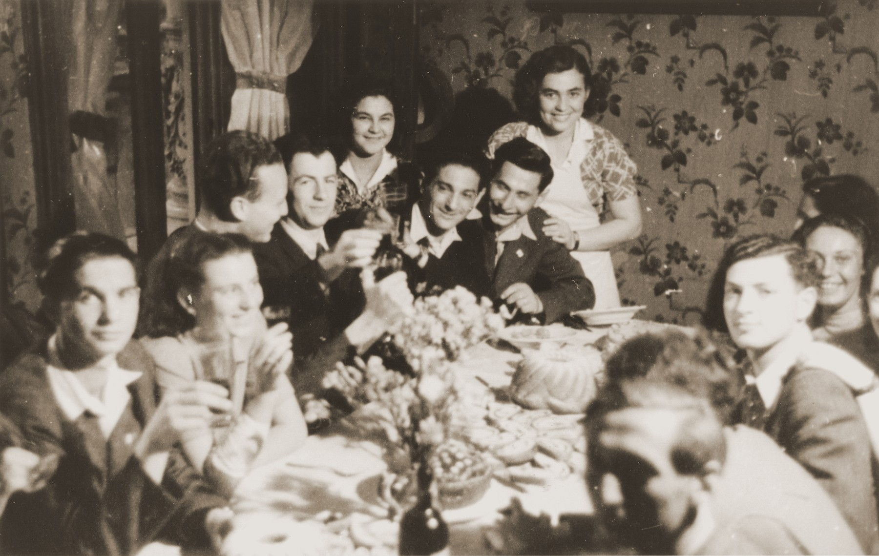 A party for Bricha workers held at Frankgasse 2, Vienna.  Among those pictured are Juzik Waiss, Sjziamer Hertzberg, Bronislav, and George Birman.