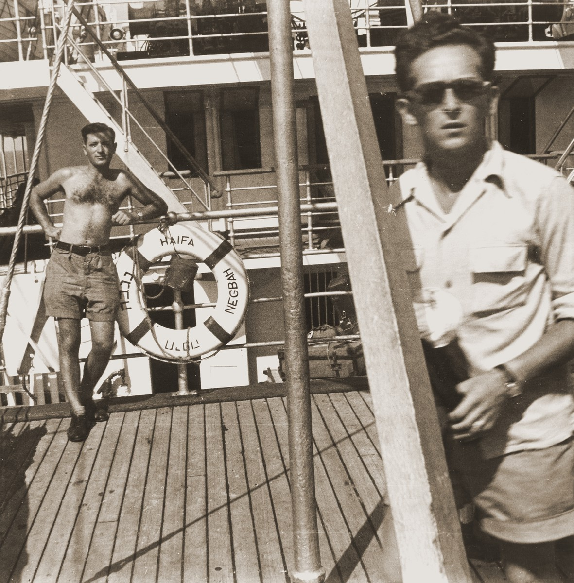 George Birman (left) on the deck of the Negba before the ship's departure from Marseilles.